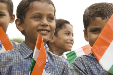 School boys holding the Indian flag