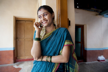 Rural woman talking on a mobile phone