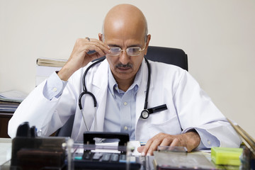 Doctor looking at a report
