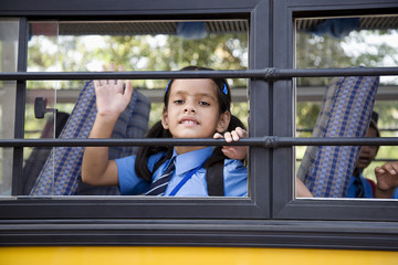 School girl sitting in a school bus