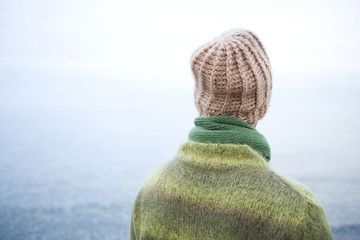 Man Wearing A Knit Hat While Looking Out To Sea