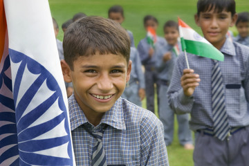 Portrait of a school boy with the Indian flag
