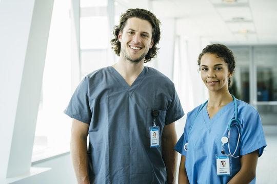 Portrait of Male and Female Nurses in Hospital Hallway