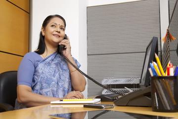 Senior woman executive talking on a phone