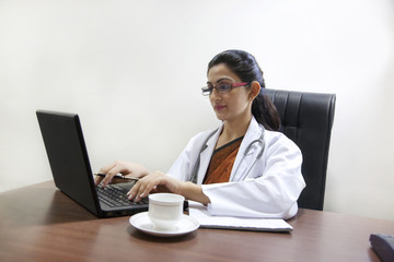 Doctor working on a laptop