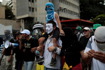 Opposition supporters rally against Venezuela's President Nicolas Maduro's government in Caracas