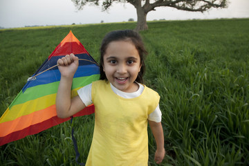 Portrait of a girl with a kite