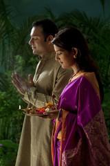 Couple praying during diwali