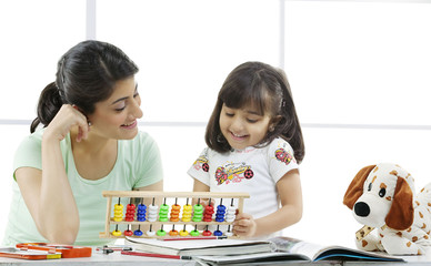 Mother and daughter with an abacus