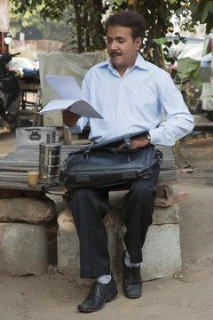 Salesman examining his paperwork