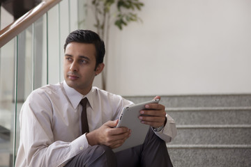 Male executive with a tablet