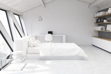 White bedroom in an attic, side view