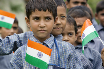 School girl holding the Indian flag