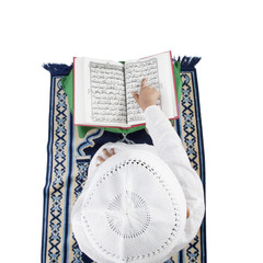 Muslim boy reading the Quran
