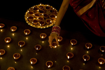 Woman arranging diyas