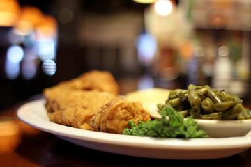 Deep fried chicken dinner at a restaurant.