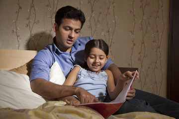 Father reading a story to daughter