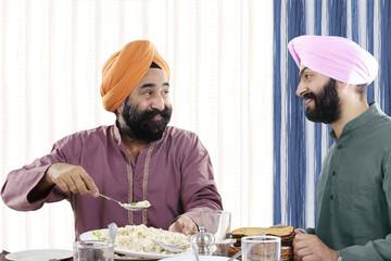 Sikh men having lunch