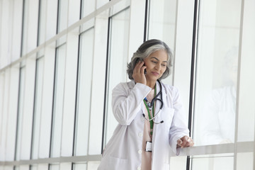 Female doctor talking on a mobile phone