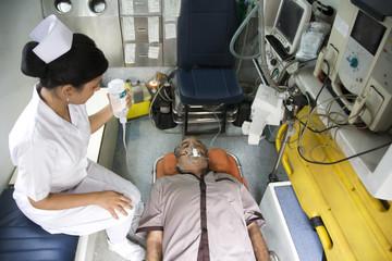 Nurse with a patient inside an ambulance