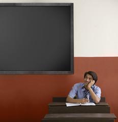 Boy daydreaming in a classroom
