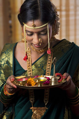 Young bride taking a bow with offerings