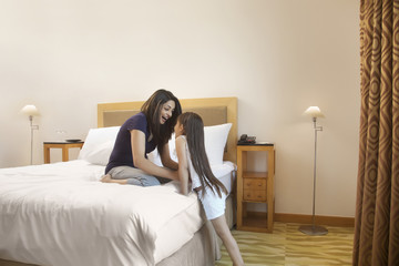 Mother and Child playing in bedroom
