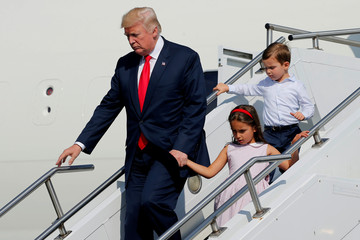 Trump, with his grandchildren, arrives aboard Air Force One for a summer vacation at his Bedminster estate, at Morristown Airport in Morristown, New Jersey