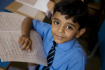 School boy with his notebook