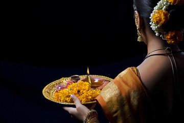 Rear view of woman celebrating Diwali festival