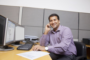 Portrait of a business executive talking on a mobile phone