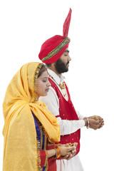Sikh couple praying
