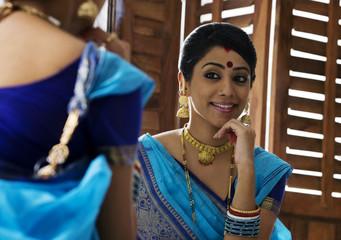 Bengali woman admiring herself in a mirror