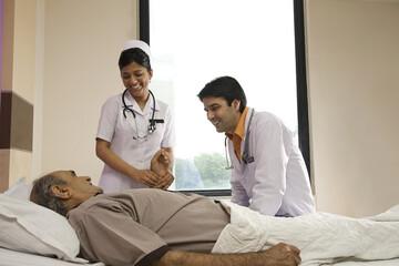 Nurse checking a patient's pulse