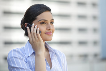 Female executive with a mobile phone