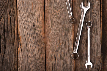 wrenches on wooden background