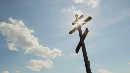 Wooden orthodox Cross in front of blue sky
