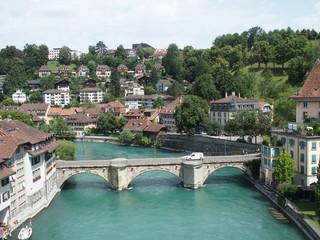Stony bridge over clean alpine Aare river in city of Bern