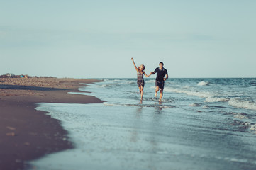 Young couple in love walking on the beach