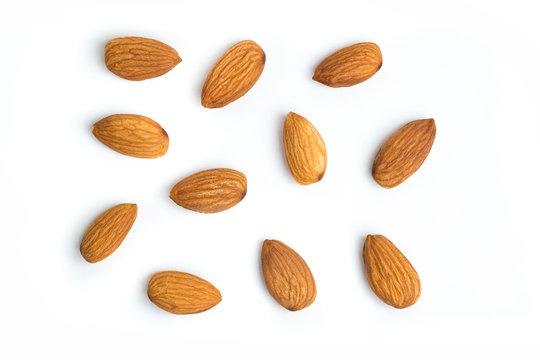 Almond nuts on isolated white background