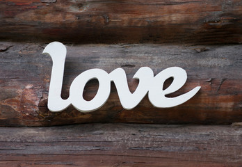Love word in retro style on wooden background