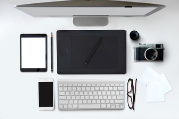 Creative professional designer's desk with designer digital tablet from above.