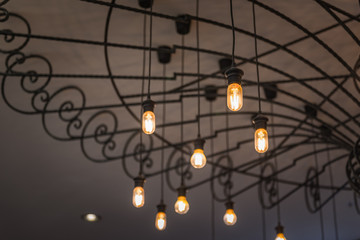 group of hanging lights in coffee shop with shallow depth of field