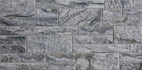 Wall Mural - Abstract, geometric, tiled pattern of solid stone