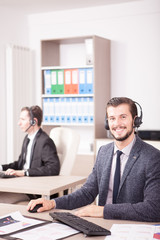 Employe from Customer service support working in office. Professional online and telephone assistant support