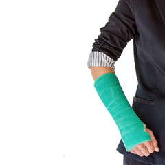 Closeup of a broken arm in a cast isolated on white background