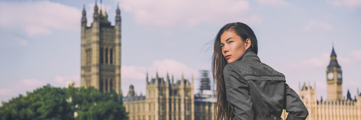 Wall Mural - London fashion woman at Westminster banner. Asian businesswoman in grey coat. Asian beauty model outdoor panorama crop for header.