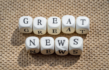 great news words made from toy cubes with letters