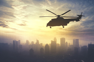Army helicopter flying at sunrise time