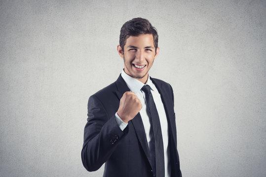 happy young businessman celebrates success